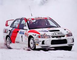 Mitsubishi Lancer Evolution Rally Car in snow