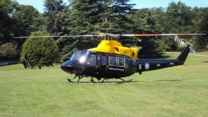 Helicopter landing at Cholmondeley Castle