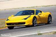 Ferrari 458 Italia in yellow going around a track