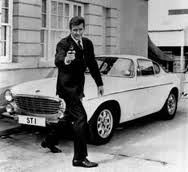 Roger Moore as the Saint with his Volvo