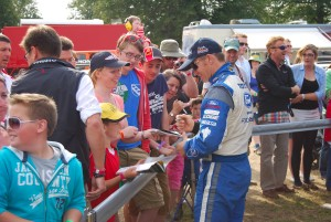 Petter Solberg signing autographs at Carfest
