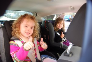 Kids thumbs up in back of focus